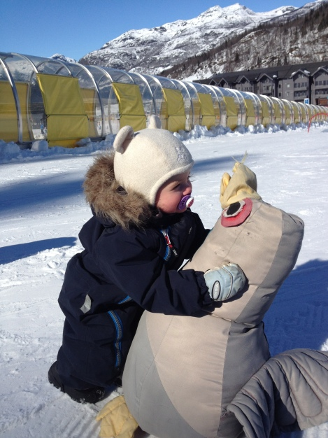 My daughter hugging a penguin in the children's slope