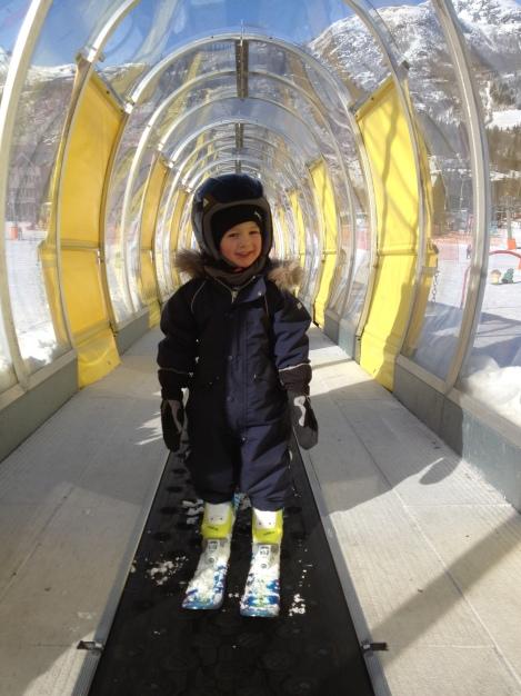 My son in the children's ski lift